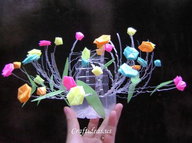 straw and plastic bottle flower pot
