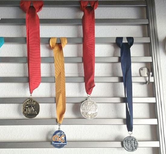 Old Crib Rail Medal Storage Idea